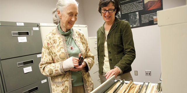 Jane Goodall and Anne Pusey with decades of research data. Photo by Megan Morr. Duke University Press Office.
