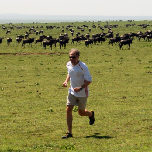 Dan Leiberman running in the Serengeti.