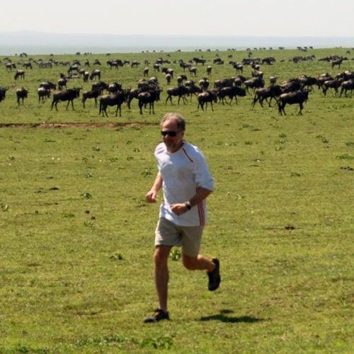Dan Leiberman running in the Serengeti.