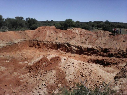 One of the mining pits at Canteen Kopje that was dug in less than 24 hours in March 2016 before a halt was ordered. Over 2 million years of the archaeological record are destroyed. (Photo anonymous)