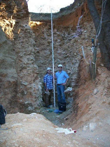 The ancient alluvial gravels which are packed full of stone tools also contain small amounts of diamonds. Here archaeologists stand in front of a sequence that dates from 1.7 million years ago near the bottom to 1.2 million years at the top. The red sands capping the gravels contain important later stone age artifacts as well. Photo shows Ryan Gibbon (left) and the author.