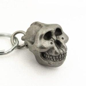 Handcrafted pewter Zinjanthropus keychain.